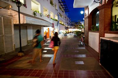 Shoppers at dusk, Puerto Vallarta, Mexico, 2011