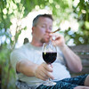 Matt with glass in wine and stogie in the garden