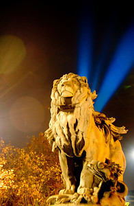 Triple exposure of a lion in Paris France with the Eiffel Tower blue lights emanating from behind.