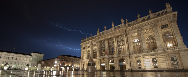 Lighting across the Piazza Castello in Turin Italy.  I loved sitting in the rain to get this shot!  I don't think Matt did as much :)