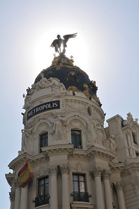 The Edificio Metropolis is a beautiful Parisian style building located at the intersection of Gran Via and Calle de Alcala in Madrid Spain.  Built in 1905, this ornate structure is surrounded by many other elegant buildings from the same period.  The Gran Via district features many fine hotels and tourist attractions.
