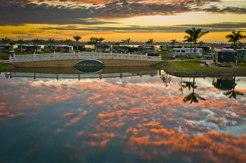 Cotton Candy Reflection Over One Of The Myakka River Motorcoach Resort Lakes