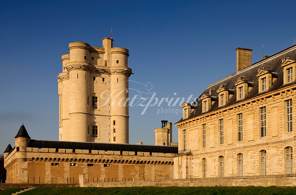 Warm evening light illuminates the donjon of Château de Vincennes. This donjon (or keep) has become the highest remaining construction of this type in Europe.
