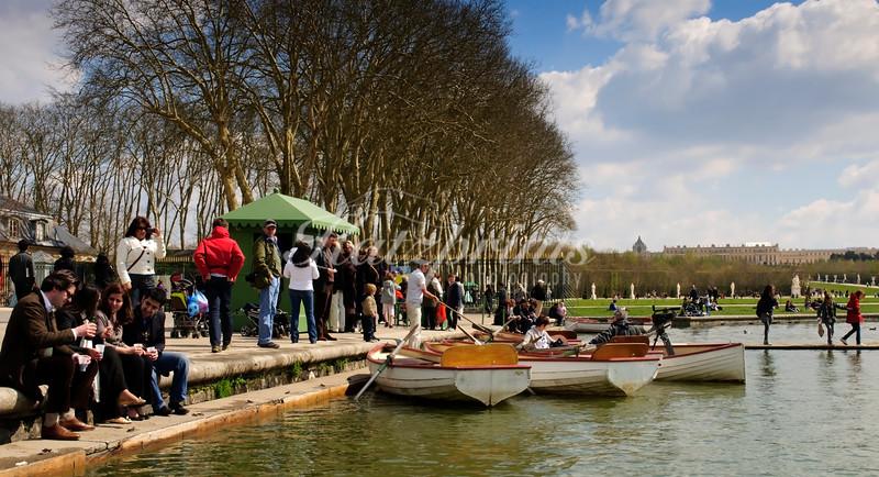 Visitors enjoy a spring day around Versailles