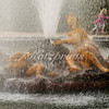 A child runs behind the fountain of Flora, Roman goddess of flowers, gardens and spring, at Château de Versailles
