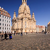 The Frauenkirche in Dresden, Germany, was built in the 18th century. The church's most distinctive feature is its dome, an engineering feat comparable to Michelangelo's dome for St. Peter's Basilica in Rome. The Frauenkirche withstood several days of bombing in 1945 but finally collapsed on February 15, 1945 due to the extreme heat caused by the raid. For decades the charred ruins stood as a memorial against war. After Germany's reunification, a citizen's initiative promoted the rebuilding of the Frauenkirche and after 13 years of rebuilding, the church was reconsecrated in October 2005. The dark stones are original stones from the rubble.