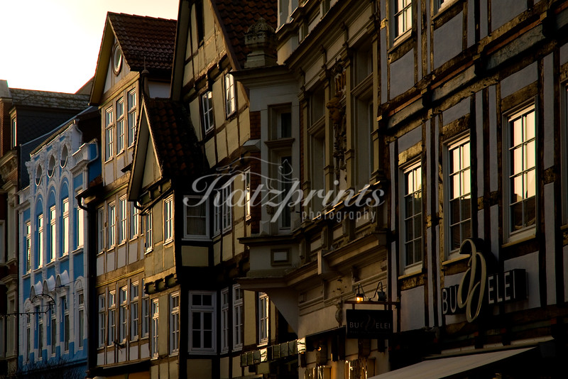 Evening light is reflected in the windows of half-timbered houses in the city of the Pied Piper, Hamelin (Hameln)