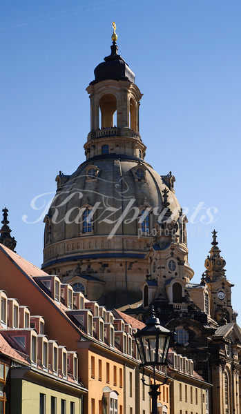 The dome or cupola of Dresden's famous Frauenkirche can be seen behind colorful houses