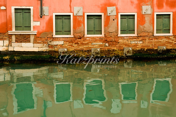 """I shot this reflection scene in Venice, Italy, during a rather rainy springtime visit. Venice is a truly glorious place which has the feel of a big outdoor museum to it. The best way to explore this ancient city is by walking its well-worn streets without worrying about directions. Those who dare to """"get lost"""" are rewarded with something interesting at every turn and will return home rich in experiences that stretch well beyond the familiar landmarks."""