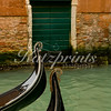 Two gondolas with front decoration on little canal in Venice (color)