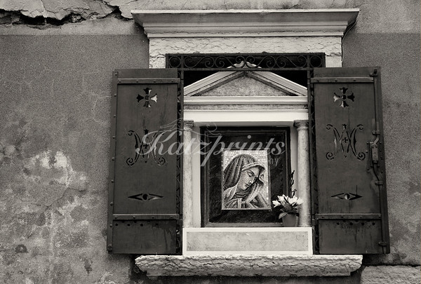 Places of worship can be found around many corners in Italy. This one was photographed in Venice. The original color photograph was converted to black-and-white with a slight sepia tone.