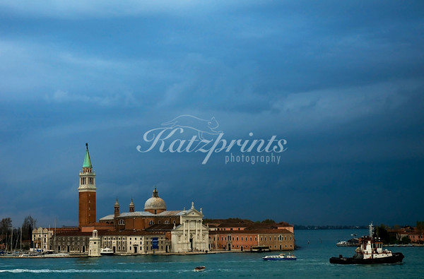 While the ancient city of Venezia is a great location to capture in sepia or black-and-white, color photography certainly has its place as well. The decaying palaces showcase a beautiful array of yellow, orange and pink tones which are complemented by the green waters of the countless canals. In this photo, an approaching spring thunderstorm makes the colors pop.