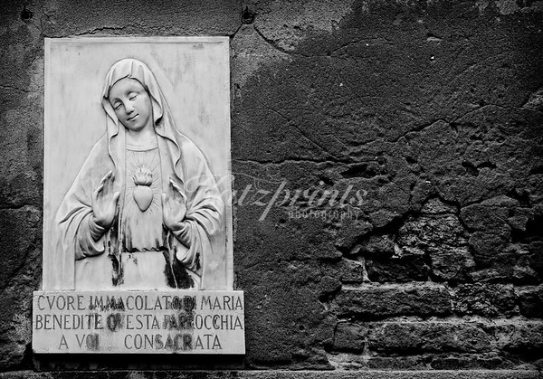 Places of worship can be found around many corners in Italy. This one was photographed in Venice. The original color photograph was converted to black-and-white to coinvey the feeling of old.