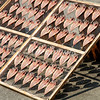 Fish is displayed on drying racks in the harbor of Ajiro