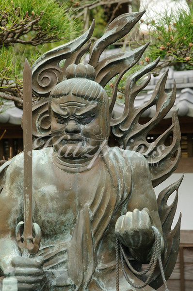 The Fudō-myōō is the best known of the Five Wisdom Kings; he usually holds a sword and a lariat and is clad in monastic rags. This sculpture can be seen at Hase-dera temple in Kamakura.