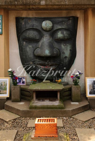 The head is the only remains of the Ueno Daibutsu, a giant bronze buddha statue from 1631, that was damaged in a fire and three different earthquakes through the centuries.