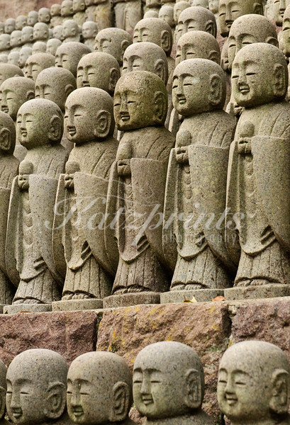 Thousands of little Jizo stone statues are standing in long rows at Hase-dera temple in Kamakura. The statues are there to comfort the souls of unborn children.