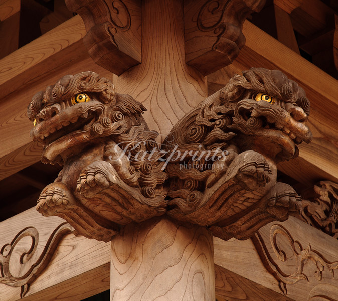 Carved lions adorn a temple in Ajiro