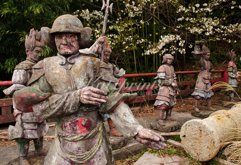 Seemingly discarded sculptures behind Atami Castle