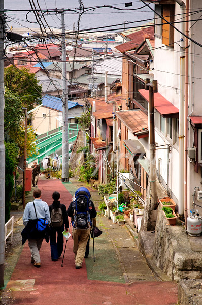Visitors are navigating the steep streets and walkways of Ajiro