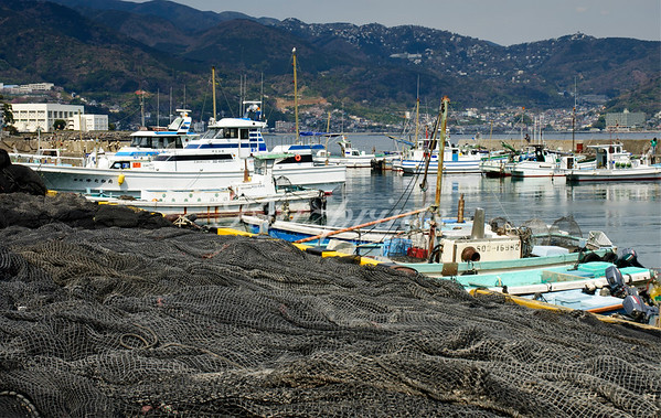 Ajiro harbor with the resort town Atami in the background