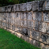 A wall of skulls at Chichen Itza<br /> <br /> This is the platform where the Mayas would stake heads to intimidate visitors