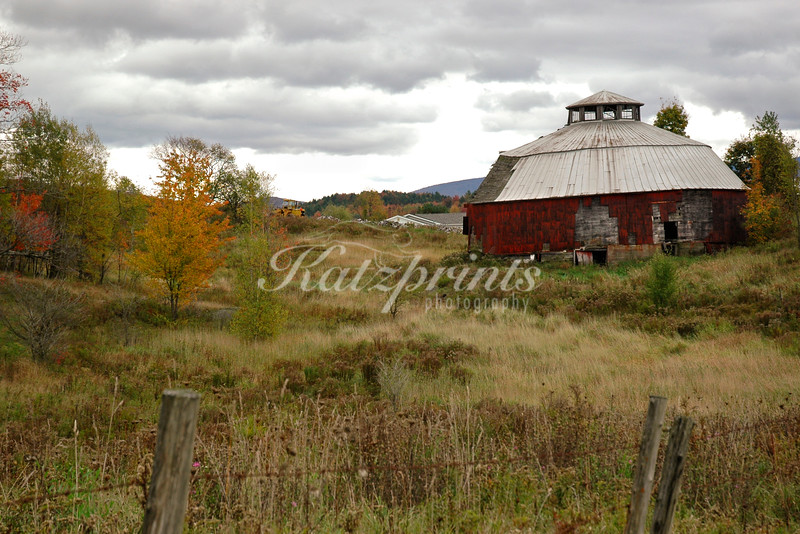 Decaying round barn with 2-pitch conical roof and cupola near Enosburg Falls in Vermont
