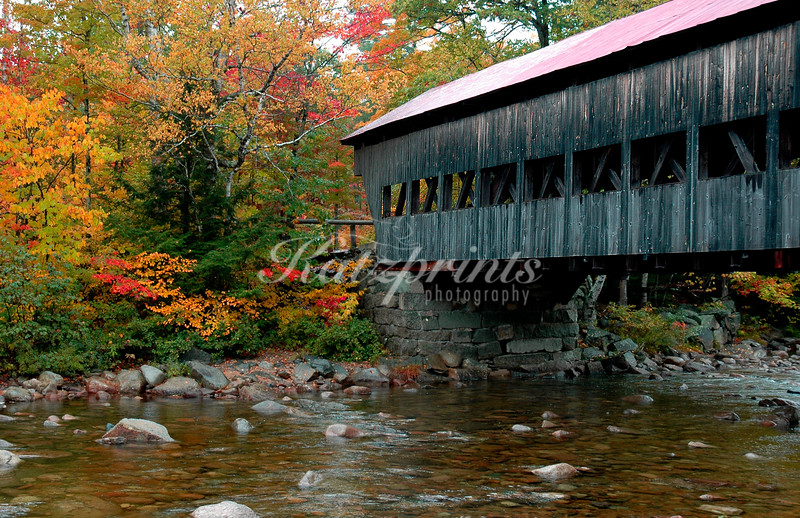 Autumn at the Abany covered bridge (built in 1858) across the Swift river, Kancamagus Highway, New Hampshire