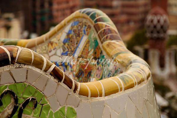 Mosaic wall in Antoni Gaudi's Parque Güell in Barcelona, Spain