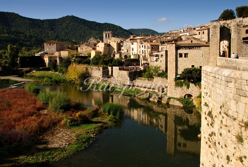 The medieval l town of Besalú is seen here from the 12th-century Romanesque bridge which crosses the Fluvià river.