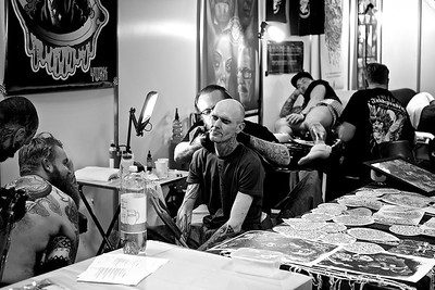 Scottish Tattoo Convention 2016, Edinburgh. Black & White photo essay exploring the trust and relationship between artist and client.  Photo ©Paul Campbell Photography.