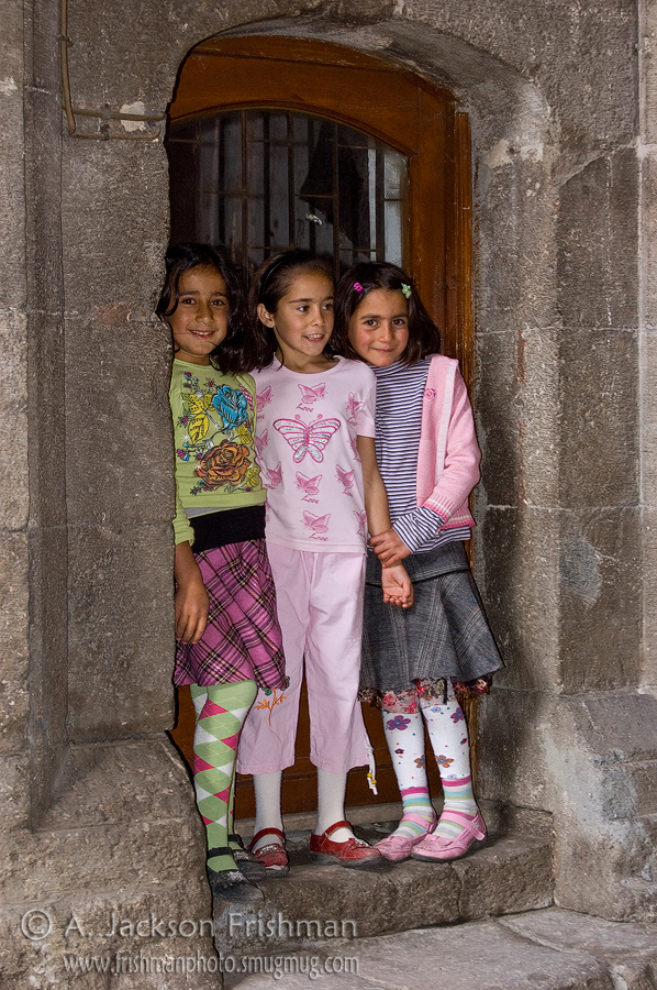 Three Turkish girls at the Çifte Minareli Medrese, Erzurum, Turkey.