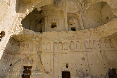 Erosion reveals the interior of a rock-cut church, Göreme, Cappadocia.
