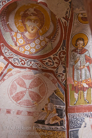 Iconography in the 11th Century Elmalı (Apple) Church, Göreme, Cappadocia, Turkey. Iconoclastic decoration is visible here underneath the later Century frescoes.