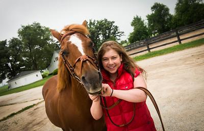 Josette Nordman rides her horse at a farm in Bourbonnais, IL on Thursday, June 26. (Photo by Jean Lachat)