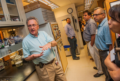 UChicagoTech representatives and  examiners from the US Patent and Trademark Office tour the lab of Dr. Richard Kraig, Tuesday, July 14, 2015, at the Gordon Center. (photo by Jean Lachat)