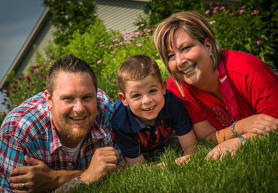 Logan with mom AnnMarie and dad Mike Fanning Sunday, July 20, 2014 at their LaPorte, IN home. (Photo by Jean Lachat)