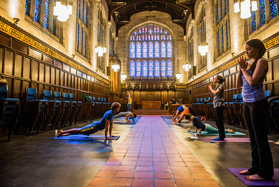 Students and community members complete sun salutations during Yoga Mala, Sunday, April 26, 2015 at Bond Chapel. (photo by Jean Lachat)