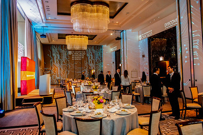 The ballroom is lit with a graphic light display Thursday, May 14, 2015 at the Langham Hotel in Chicago during the 2015 Discovery & Impact Event. (photo by Jean Lachat)