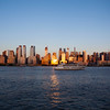 NEW YORK CITY. MANHATTAN SEEN FROM THE HUDSON RIVER DURING SUNSET.