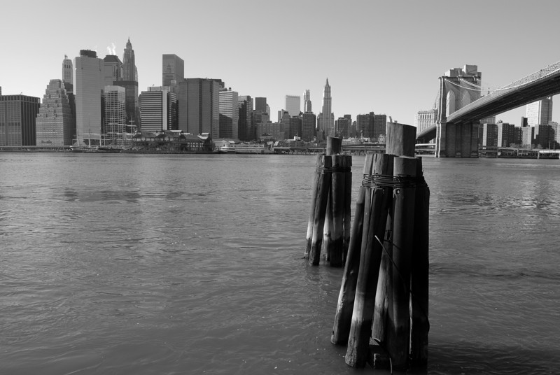 New York City Skyline from the East River under the Brooklyn Bridge