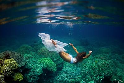 Kalia dancing through the reef in Hawaii.