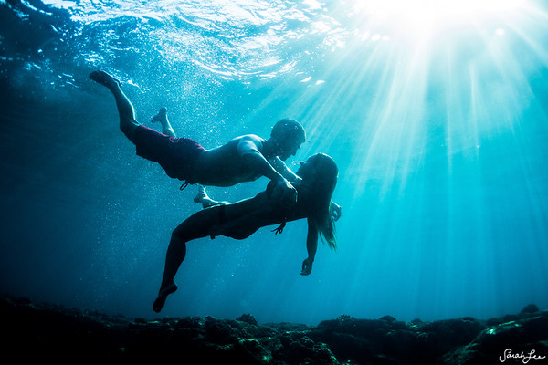 Couple underwater in Kona.