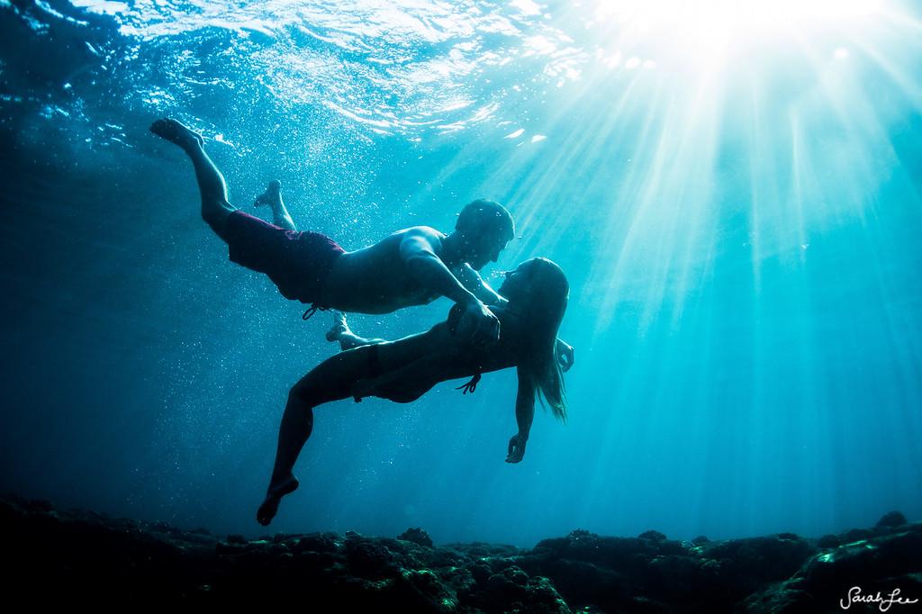 Couple underwater in Kona.