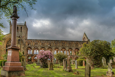 Jedburgh Abbey with a storm approaching for another grey day in England.