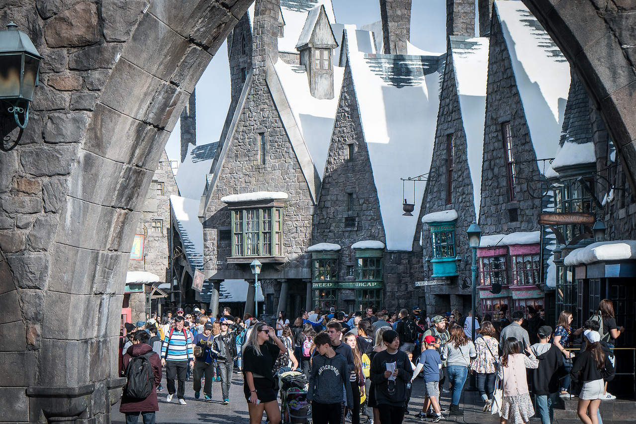 Visitors stroll through Hogsmeade