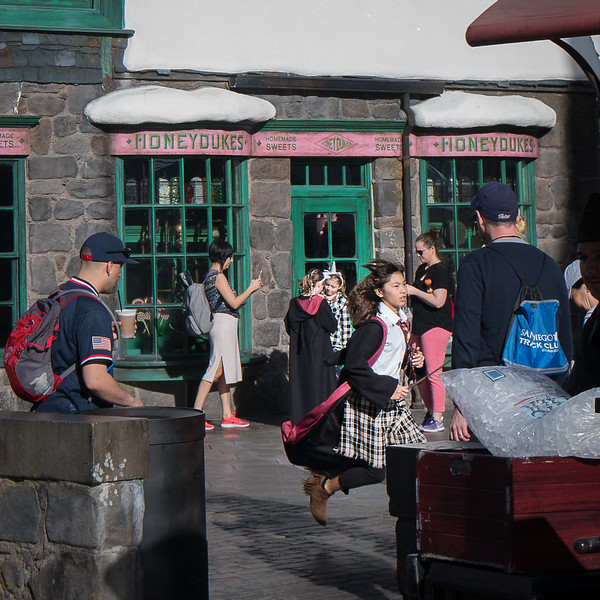 Rushing through Hogsmeade as though late for class!