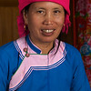 SAPA. TAVA VILLAGE. PORTRAIT OF A LOCAL ZAY TRIBE WOMAN WITH GOLD TEETH.
