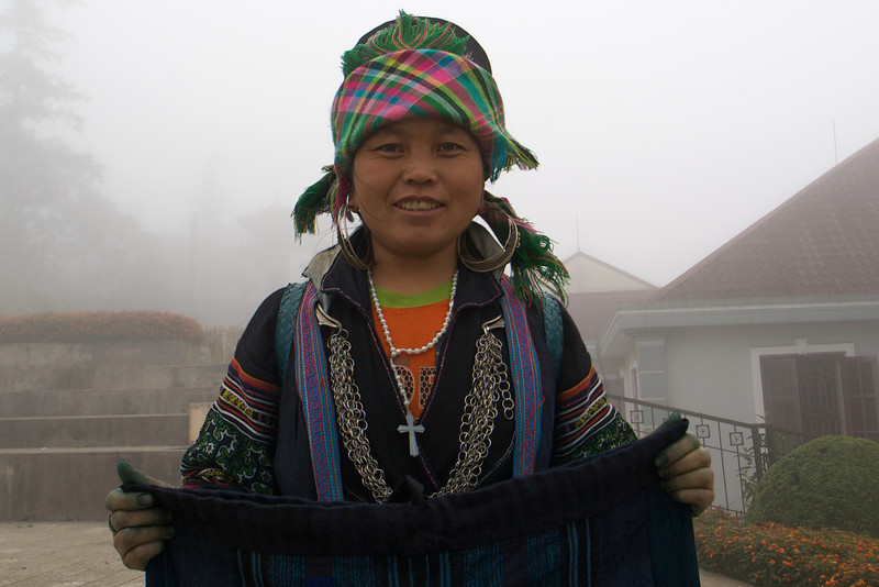 SAPA. H'MONG LADY SELLS LOCAL CLOTHES.