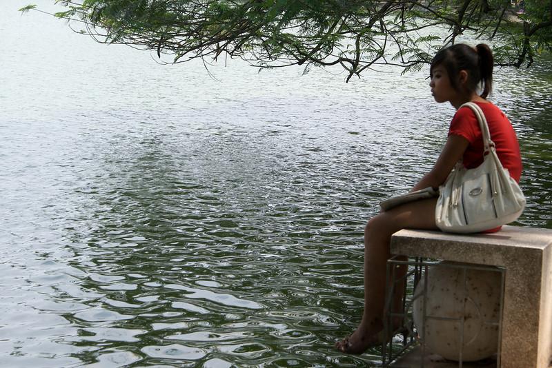 HANOI. GIRL AT HOAN KIEM LAKE.